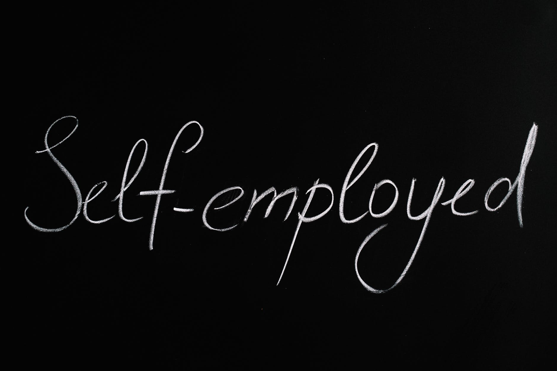 self employed lettering text on black background
